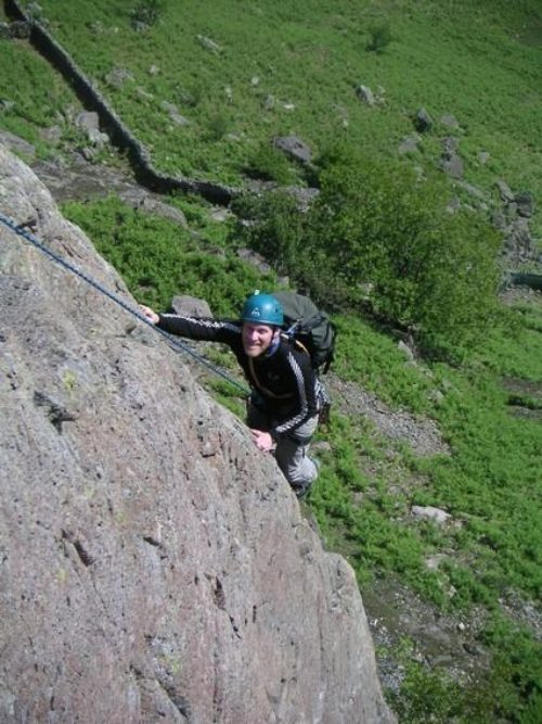 50a Pete-enjoying-the-rough-pocketed-arete-on-Route-1-Upper-Scout-Crag